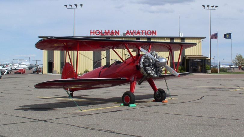 Plane Parked in front of Holman Aviation
